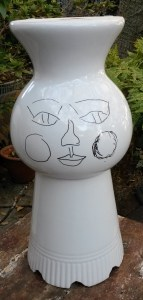 White pot with drawing